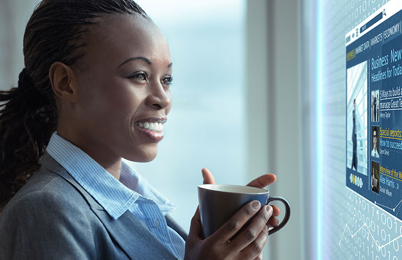 happy woman with coffee tech screen blue