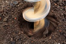drilling into the earth soil ground